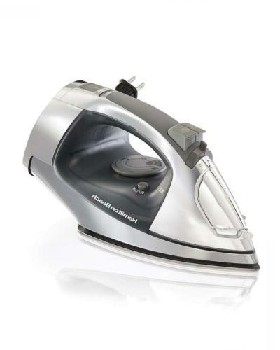 steam iron with retractable cord and stainless